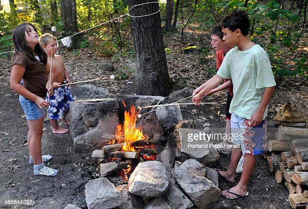PHOTOGRAPHER July 26 2008 Grand children of Robert Low and Denise Eastman enjoy toasting marshmellows around the campfire at Sebago Lake Campground...