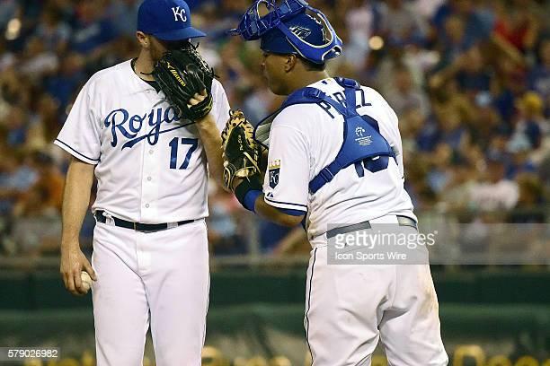Kansas City Royals' relief pitcher Wade Davis and Kansas City Royals' catcher Salvador Perez during a major league baseball game between the...