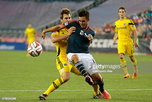 New England Revolution's Diego Fagundez is held back by Columbus Crew's Chad Barson The Columbus Crew led the New England Revolution 10 at the half...