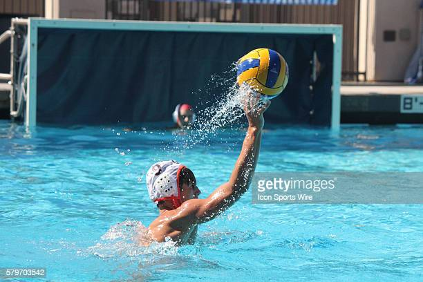 Bret Dennis of CCal Water Polo passes during the CCal Water Polo versus Tualatin Hills Water Polo match in the USA National Junior Olympics water...