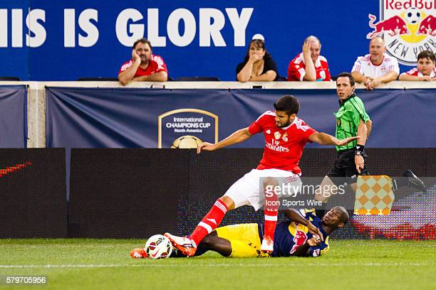 New York Red Bulls forward Anatole Abang and SL Benfica defender Lisandro Lpez go after a ball during the first half of the International Champions...
