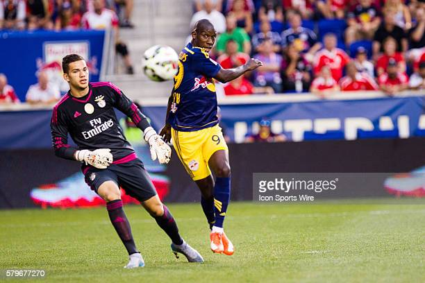 New York Red Bulls forward Bradley WrightPhillips kicks the ball away from SL Benfica goalkeeper Ederson during the first half of the International...