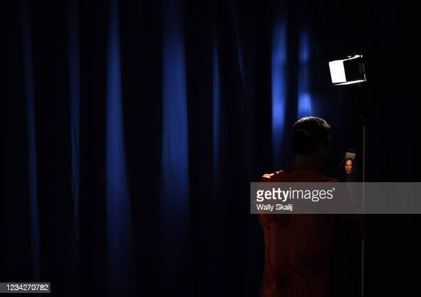 July 26, 2021: A member of the German team takes a selfie before the mens synchronized 3m springboard final at the 2020 Tokyo Olympics.