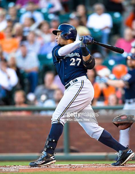 Milwaukee Brewers center fielder Carlos Gomez at bat and following the trajectory of the ball after getting 1run double in the first inning during...