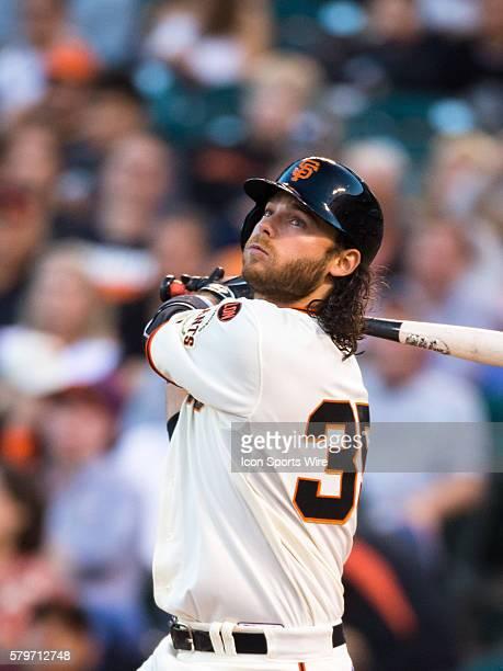 San Francisco Giants shortstop Brandon Crawford at bat and following the trajectory of the ball during the MLB baseball game between the San...