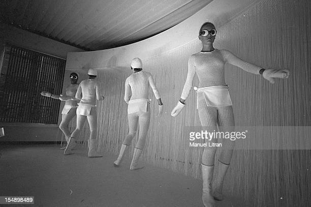 July 28 models in white models presenting the new winter collection 19691970 Andre Courreges during a rehearsal room in a white ultramodern designer