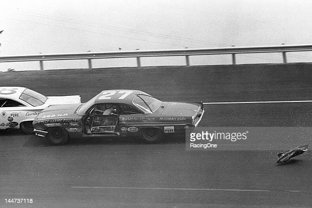 The driver's door falls off of Junior Johnson's Pontiac as he battles Fred Lorenzen during the Volunteer 500 NASCAR Cup race at Bristol Motor...
