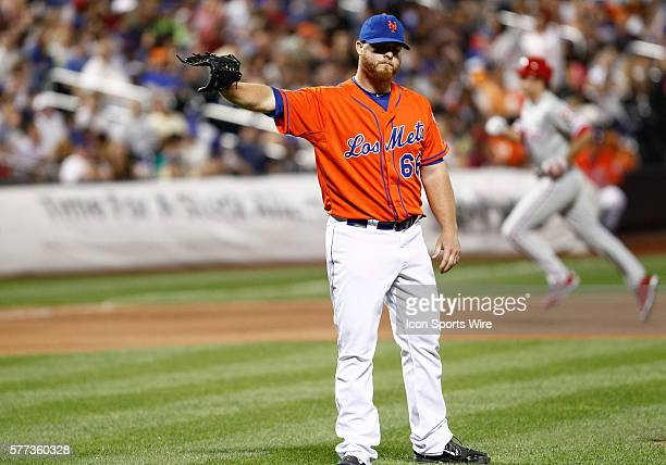 New York Mets Pitcher Josh Edgin [3949] reacts as Philadelphia Phillies Second baseman Chase Utley [3234] circles the bases after hitting a grand...
