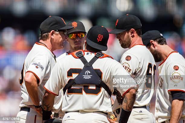 San Francisco Giants pitching coach Dave Righetti talks to San Francisco Giants relief pitcher Hunter Strickland San Francisco Giants catcher Hector...