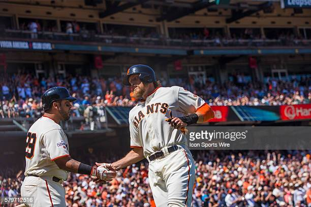 San Francisco Giants right fielder Hunter Pence celebrates scoring with San Francisco Giants catcher Hector Sanchez in the 7th inning during the MLB...