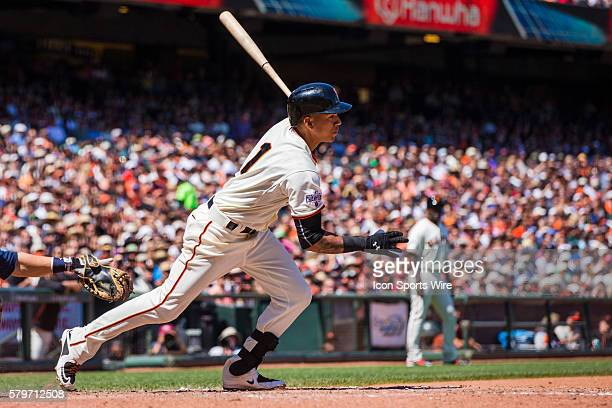 San Francisco Giants shortstop Ehire Adrianza at bat and following the trajectory of the ball during the MLB baseball game between the San Francisco...