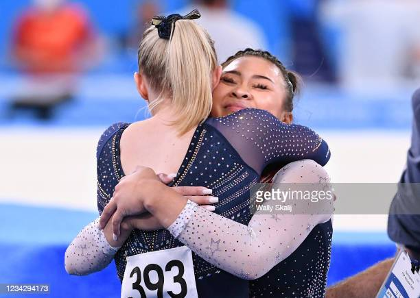 July 29, 2021: USAs Sunisa Lee is hugged by teammate Jade Carey after winning the gold medal in the womens individual all-around final at the 2020...