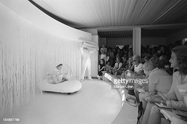 July 29 presentation of new models of the 19691970 winter collection fashion designer Andre Courreges The models on the catwalk facing the audience...