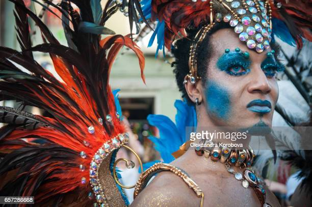 july 3, 2011, toronto, on, canada. performer during the pride parade in toronto. dressed in colorful costume made with feathers and jewels. supporting marriage equality and lgbt rights. - istock images stock pictures, royalty-free photos & images