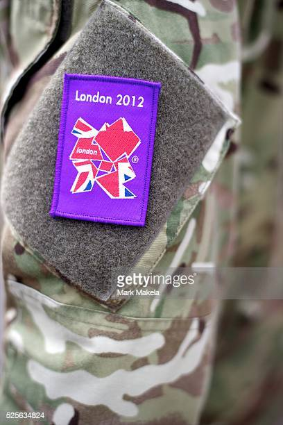 July 30 2012 London England United Kingdom A soldiers arm is festooned with a velcro patch commemorating the olympiad outside the Greenwich...