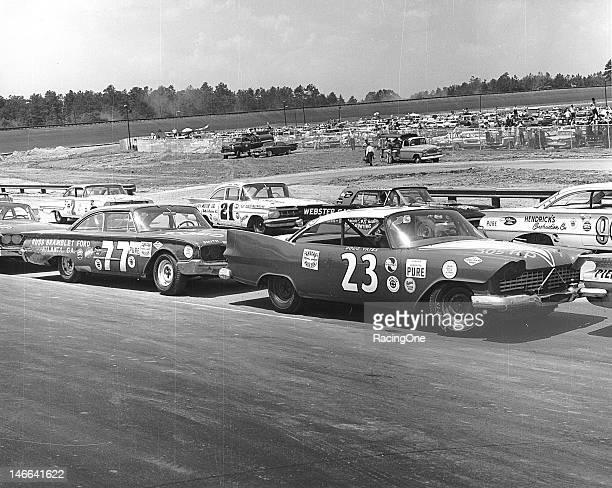 Cars are lined up on pit road before the start of the Dixie 300 the first NASCAR Cup race to be held at the new Atlanta International Raceway Cars...