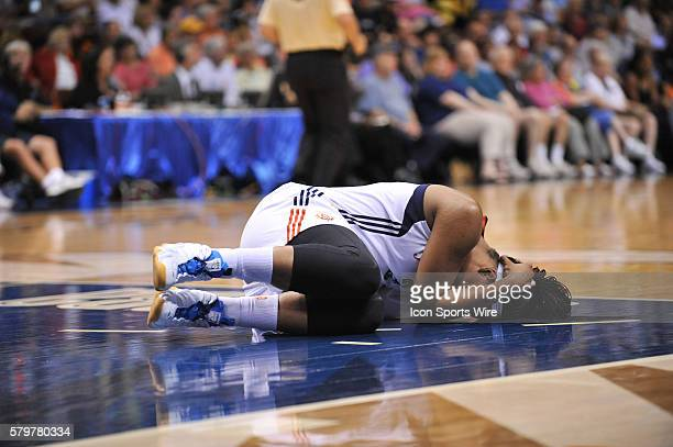 Connecticut Sun Center Kelsey Bone lays on the ground injured during the play The Connecticut Sun's host the Seattle Storm at the Mohegan Sun Arena...