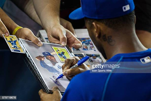 Kansas City Royals Shortstop Alcides Escobar [6238] signs autographs prior to the beginning of the MLB game between the Kansas City Royals and the...