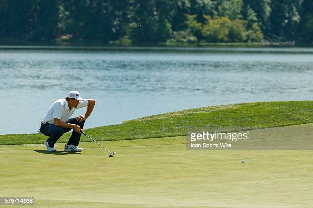 Retief Goosen prepares to putt his ball on the 18th green during the second round of the Quicken Loans National at Robert Trent Jones Golf Course in...