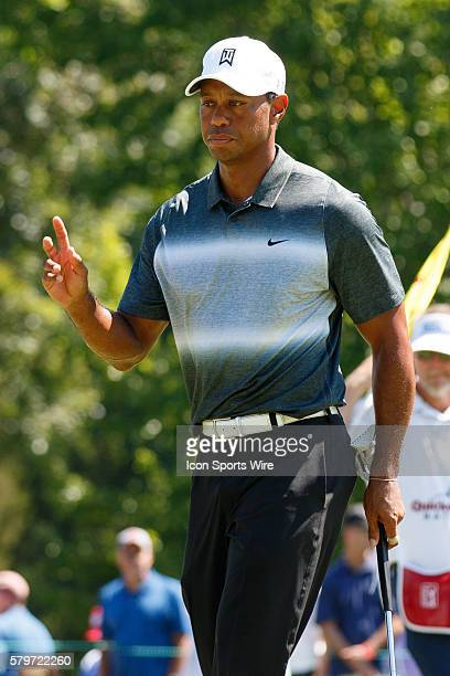 Tiger Woods acknowledges the crowd after making a birdie putt during the second round of the Quicken Loans National at Robert Trent Jones Golf Course...