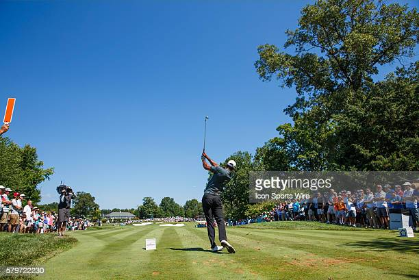 Tiger Woods hits an iron off the 4th tee box during the second round of the Quicken Loans National at Robert Trent Jones Golf Course in Gainesville,...