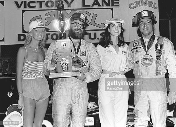 Ted Field and Danny Ongais celebrate in victory lane at Daytona International Speedway after they drove Fields' Interscope Racing Lola T600 Chevrolet...