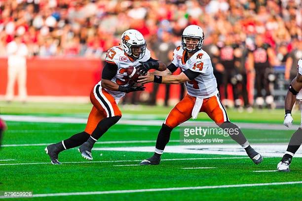 BC Lions Travis Lulay and Andrew Harris during Canadian Football League action between the BC Lions and Ottawa RedBlacks at TD Place in Ottawa ON...