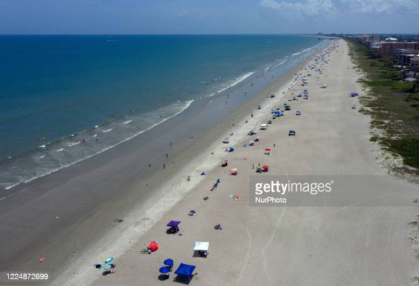 July 4, 2020 - Cape Canaveral, Florida, United States - In this aerial view from a drone, people celebrate Independence Day by visiting the beach on...