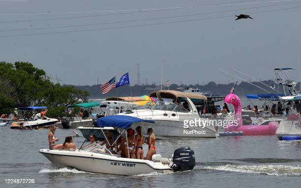 July 4 2020 Merritt Island Florida United States People celebrate Independence Day by boating and swimming on the Indian River on July 4 2020 in...