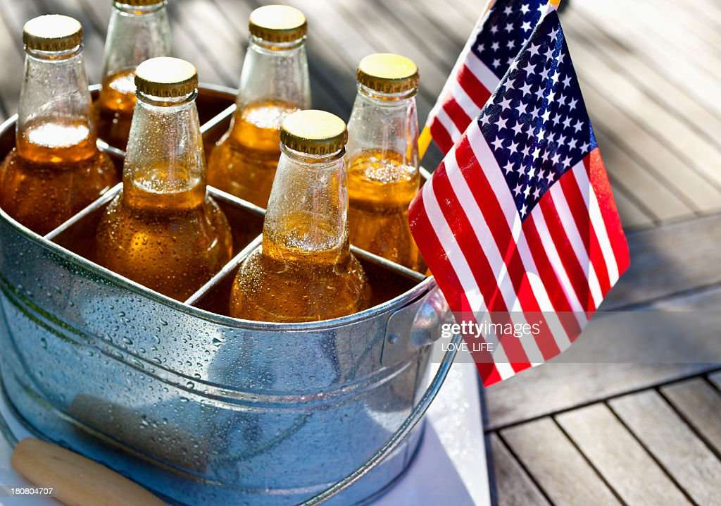 July 4th, Beer and American flags. : Stock Photo