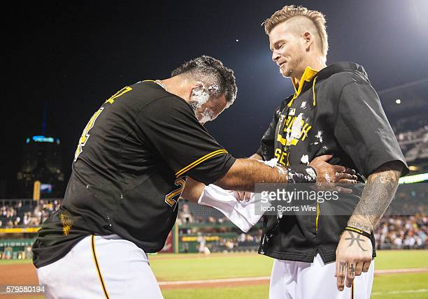 Pittsburgh Pirates first baseman Pedro Alvarez gets a whipped cream pie in the face from starting pitcher AJ Burnett after hitting a walk off single...
