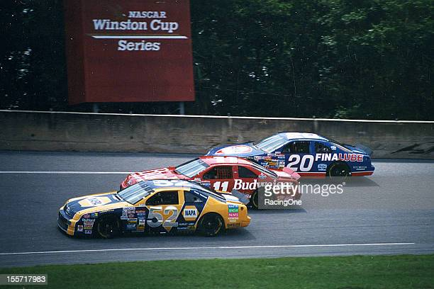 In his final race as a driver at Daytona International Speedway Jimmy Means tries to hold off Bill Elliott and Bobby Hamilton during the Pepsi 400...