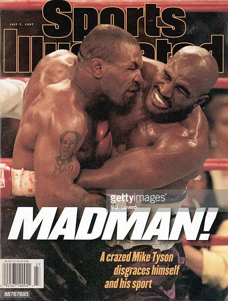 July 7, 1997 Sports Illustrated via Getty Images Cover: Boxing: WBA Heavyweight Title: Mike Tyson in action, biting off ear of Evander Holyfield...