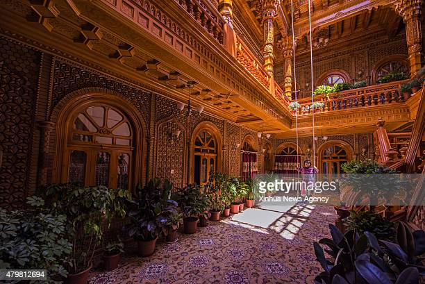 KAX July 7 2015 Photo taken on June 8 2015 shows a child swinging at the courtyard in the old town of the old town of Kax northwest China's Xinjiang...