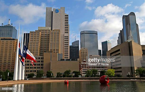 July 8,2016: The flags in front of Dallas City Hall were lowered to half mast against the skyline after the fatal shootings of five police officers...