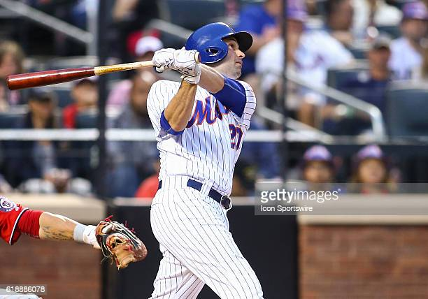 New York Mets Second baseman Neil Walker [4964] hits a sac fly to center, scoring New York Mets Infielder Jose Reyes [3276] during the first inning...