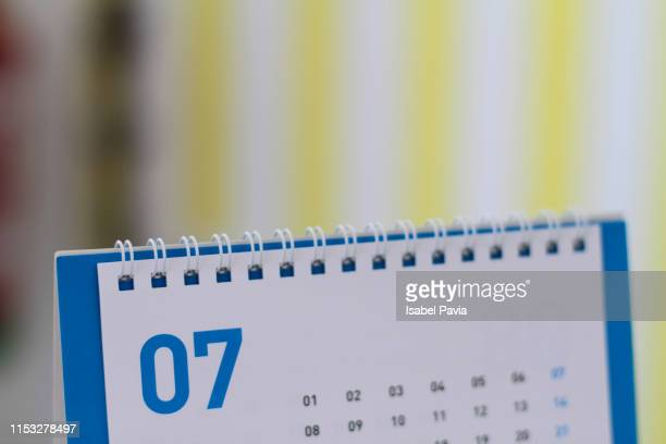 july calendar folder - july stock pictures, royalty-free photos & images