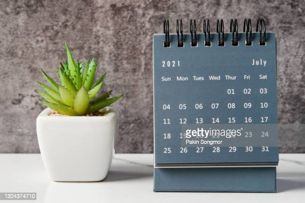 july month, calendar desk 2021 for organizer to planning and reminder on the table. business planning appointment meeting concept - july stock pictures, royalty-free photos & images