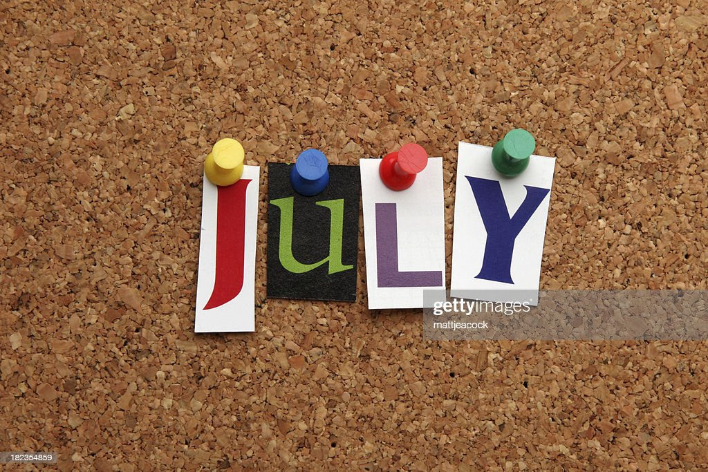 July pinned on noticeboard : Stock Photo
