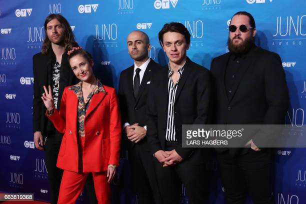 July Talk arrives on the red carpet before the JUNO awards at the Canadian Tire Centre in Ottawa Ontario on April 2 2017 / AFP PHOTO / Lars Hagberg