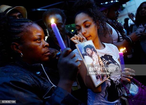 Julya Baer is emotional during a candlelight vigil in Leimert Park in memory of musician Prince on April 21 in Los Angeles California Prince died...