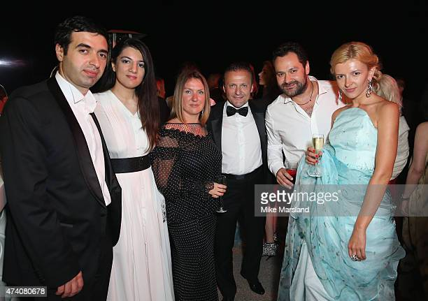 Juma Ahmad Zada and wife Gyunel Rustamova with guests attending the De Grisogono Divine In Cannes Dinner Party at Hotel du CapEdenRoc on May 19 2015...