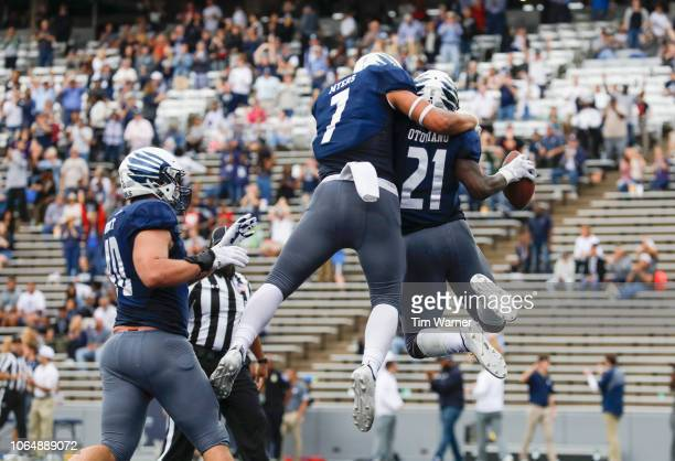 Juma Otoviano of the Rice Owls is congratulated by Jordan Myers after a second half touchdown against the Old Dominion Monarchs at Rice Stadium on...