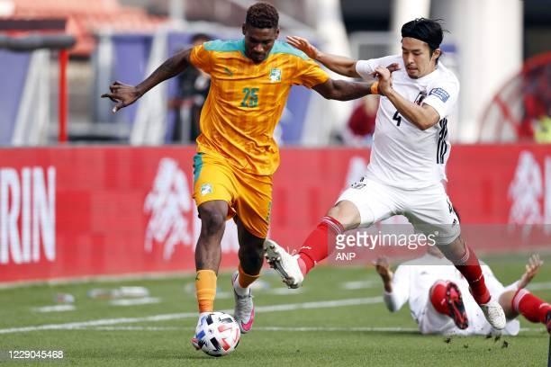 Juma Saeed of Ivory Coast, Yuta Nakayama of Japan during the friendly match between Japan and Ivory Coast at Stadium Galgenwaard on October 13, 2020...