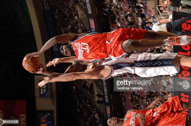 Jumaine Jones of the Charlotte Bobcats goes to the basket against Jason Collins of the New Jersey Nets on December 14 2005 at the Continental...
