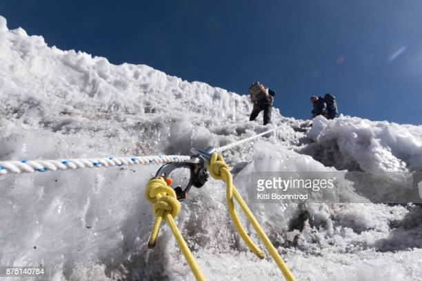 Jumaring with fixed rope to the top of Lobuche east peak in Nepal