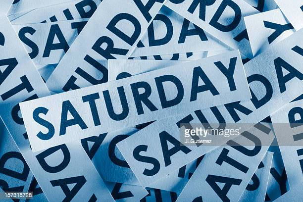 jumble of paper cutout pieces containing the word saturday - saturday stock pictures, royalty-free photos & images