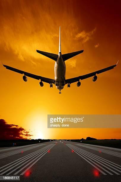 XXXL jumbo jet airplane landing at sunset