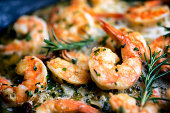 Jumbo Shrimp Scampi Sauteeing in Butter and Olive Oil