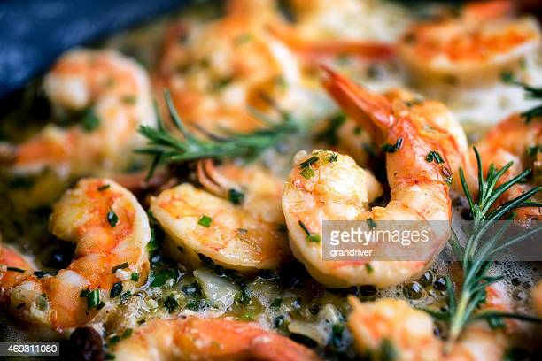 jumbo shrimp scampi sauteeing in butter and olive oil - seafood stock pictures, royalty-free photos & images